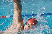 Young swimmer doing front crawl swimming stroke