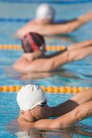 Swimmers doing backstroke swimming