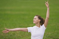 Young Woman Widely Stretching Arms