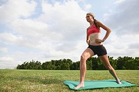 Young Woman doing exercise on mat