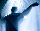 Person hiding behind a curtain
