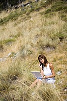 Woman nature laptop.