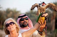 Bab Al Shams Desert Resort, arab man explains wild animal to european woman, Dubai, United Arabian Emirates