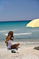 Woman beach sunshade