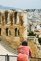 Tourist in an ancient amphitheater, Theatre of Dionysus, Acropolis, Athens, Greece