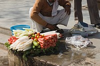 Vendor selling vegetable in a street, New Delhi, India