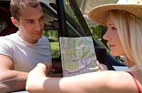 young couple, woman holding a map
