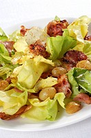 prickly lettuce with bacon and grapes