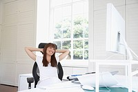 Pacific Islander woman relaxing at desk