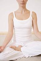 A woman sitting cross_legged