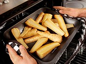 Man Roasting Parsnips