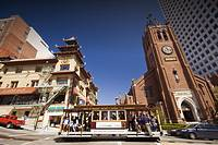 Historical San Francisco corner and a tram passing by, California, USA