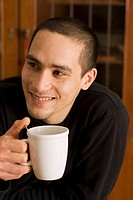Man holding mug and smiling