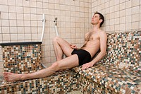 Man reclining in steam room