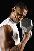 African man doing biceps curl with dumbbell (thumbnail)