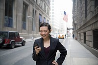 Businesswoman using mobile phone and smiling