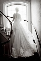 Bride standing on spiral staircase