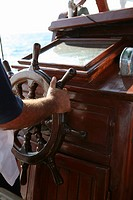 Man standing at the helm of a boat