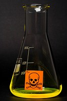 Toxic label on conical flask containing yellow liquid