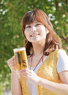 Woman holding beer mug