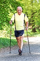 A senior training for fitness with nordic walking