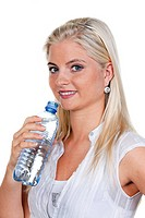 thirsty woman drinking mineral water from plastic bottle
