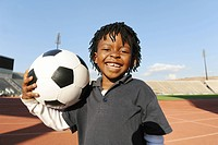 Young boy with football, Super Stadium, Pretoria, Gauteng Province, South Africa