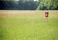An emergency telephone in a field