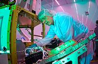 Martin Leahy performs voltage and continuity tests on a tactical satellite, or TacSat-3, at the Air Force Research Laboratory on Kirtland Air Force Ba...