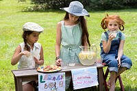 Three girls with a lemonade stand