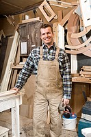 A carpenter standing in a workshop