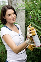 Woman spray gardening