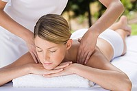 Young woman receiving massage (thumbnail)