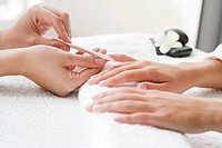 Woman receiving manicure (thumbnail)