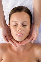 Young woman receiving facial massage (thumbnail)