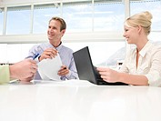 Smiling businesspeople at meeting table