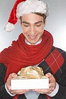 Young man holding a christmas gift