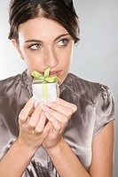 Woman holding a small gift