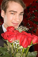 Romantic man with a bunch of roses