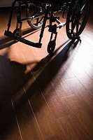 Wheelchair on a wooden floor (thumbnail)