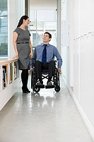 Disabled office worker with colleague