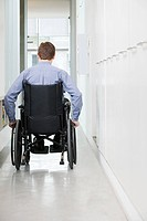 Rear view of a man in a wheelchair