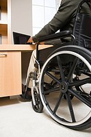 Rear view of a disabled man in a wheelchair