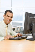 Male office worker at desk