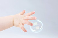 Hand of baby and bubble