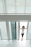 Woman opening patio doors