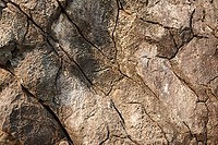 Close up image of cracked rocks