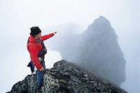 Man pointing towards a mountain peak Marma Sweden.