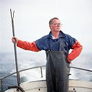 Senior man standing on boat
