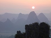 Sun in the haze above the mountains, Guilin, Guangxi, China